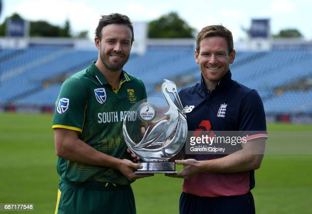 South Africa captain AB de Villiers and England captain Eoin Morgan hold the series trophy at Headingley on May 23 2017 in Leeds England