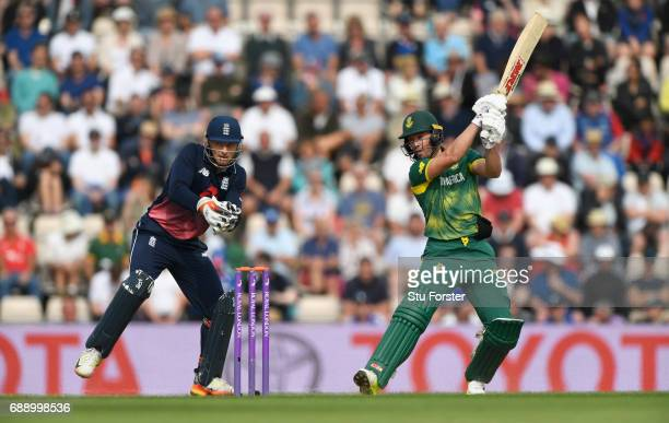 South Africa captain AB de Villiers drives to the boundary watched by Jos Buttler during the 2nd Royal London One Day International between England...