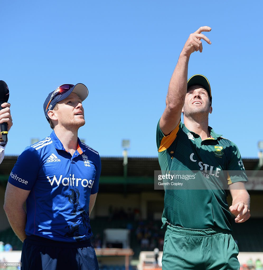 South Africa captain AB de Villiers tosses the coin alongside England captain Eoin Morgan ahead of the 2nd Momentum ODI between South Africa and England at St George's Park on February 6, 2016 in Port Elizabeth, South Africa.