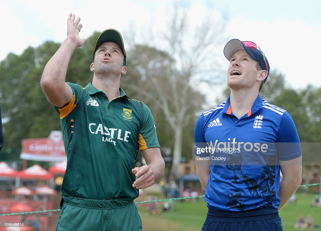 South Africa captain AB de Villiers tosses the coin alongside England captain <a gi-track='captionPersonalityLinkClicked' href=/galleries/search?phrase=Eoin+Morgan&family=editorial&specificpeople=689581 ng-click='$event.stopPropagation()'>Eoin Morgan</a> ahead of the 3rd Momentum ODI match between South Africa and England at Supersport Park on February 9, 2016 in Centurion, South Africa.