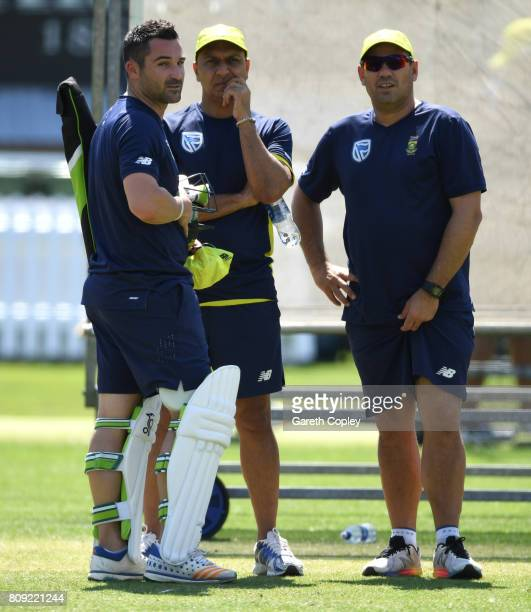 South Africa captain Dean Elgar speaks with coach Russell Domingo during a nets session at Lord's Cricket Ground on July 5 2017 in London England