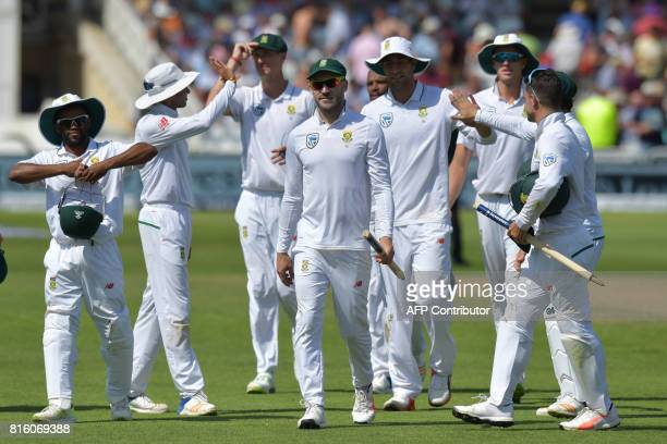 South Africa captain Faf du Plessis and south Africa's players carry the stumps as they leave the field on the fourth day of the second Test match...