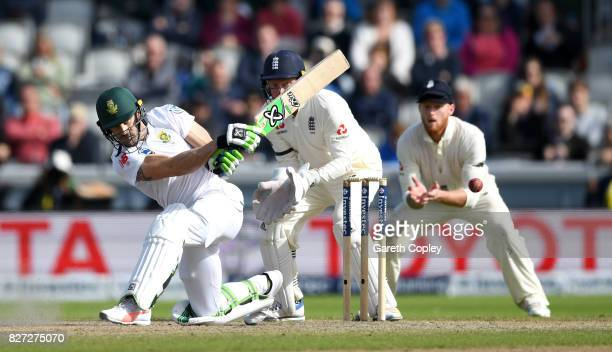 South Africa captain Faf du Plessis bats watched by England wicketkeeper Jonathan Bairstow during day four of the 4th Investec Test match between...