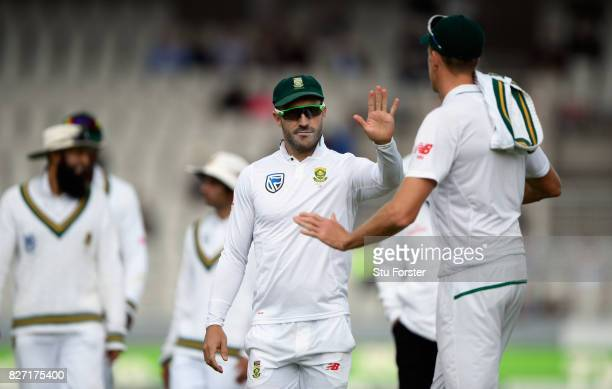South Africa captain Faf du Plessis congratulates bowler Morne Morkel during day four of the 4th Investec Test match between England and South Africa...