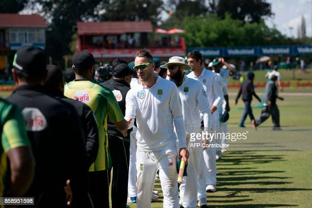 South Africa Captain Faf du Plessis holds one of the stumps as he congratulates Bangladesh players after South Africa won at the end of the third day...