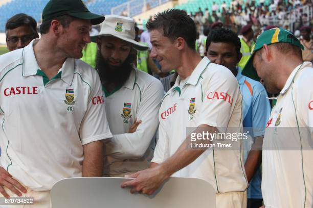 South Africa captain Graeme Smith Man of the Match Hashim Amla bowler Dale Steyn and Jaques Kallis makes thumbs up sign during the prize distribution...