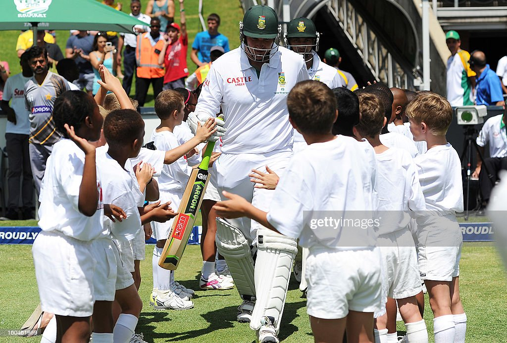 South Africa captain Greaham Smith (C) is welcomed on February 1, 2013 on the field by boys, celebrating his 100th Test captaincy, before the first Test against Pakistan at the Wanderers Stadium in Johannesburg.