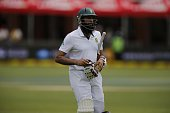 South Africa Captain Hashim Amla leaves the pitch after being bowled out by West Indies Jerome Taylor during the third day of the second cricket Test...