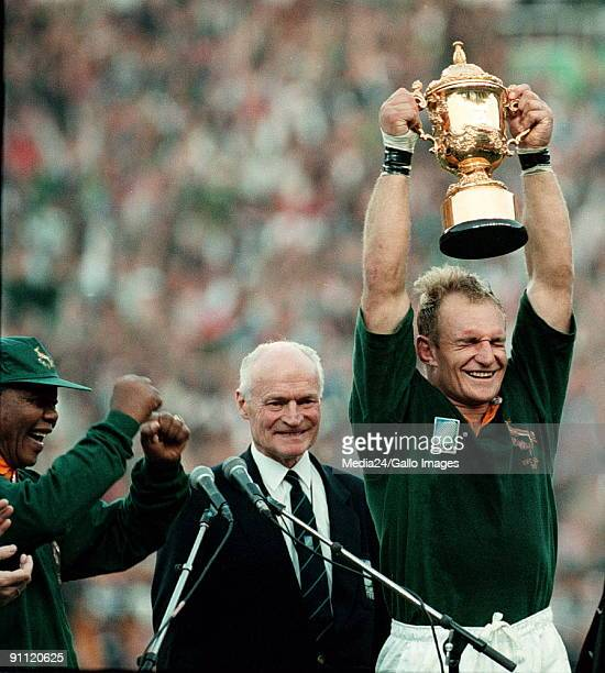 South Africa Captain of the Springbok team Francois Pienaar holds the Web Ellis trophy up high after defeating the All Blacks at the World Cup...