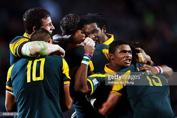 South Africa celebrate at the whistle after winning the 2014 Junior World Championship Semi Final match between South Africa and New Zealand at QBE...