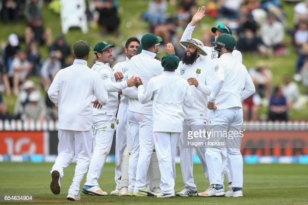 South Africa celebrate the dismissal of Jimmy Neesham of New Zealand during day three of the test match between New Zealand and South Africa at Basin...