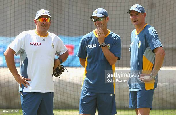 South Africa coach Russell Domingo Gary Kirsten and Mike Hussey look on during a South African Nets Session at Melbourne Cricket Ground on February...
