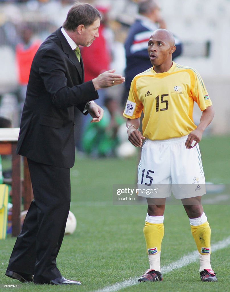South Africa coach Stuart Baxter talks with Benedict Vilakazi during the 2006 World Cup Qualifying match between South Africa and Cape Verde played...