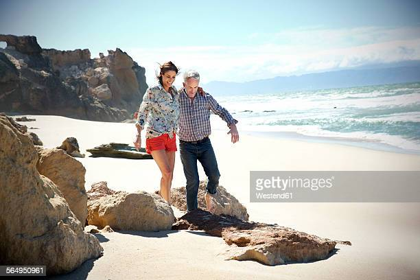 South Africa, couple walking on the beach
