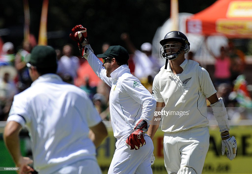 South Africa cricketer AB de Villiers (C) celebrates taking the wicket of New Zealand batsman Chris Martin during day 3 of the first Test match between South Africa and New Zealand, in Cape Town at Newlands, on January 4, 2013. South Africa won the 5 day Test in 3 days.