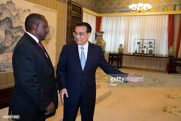 South Africa Deputy President Cyril Ramaphosa is greeted by Chinese Premier Li Keqiang prior to a meeting at the Zhongnanhai leadership compound July...