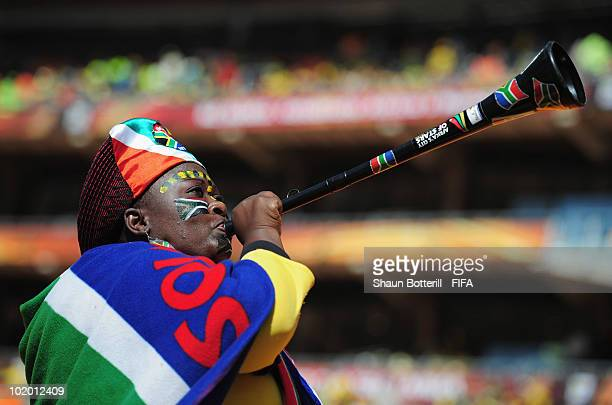 South Africa fan blows a Vuvuzela as she arrives for the Opening Ceremony ahead of the 2010 FIFA World Cup South Africa Group A match between South...
