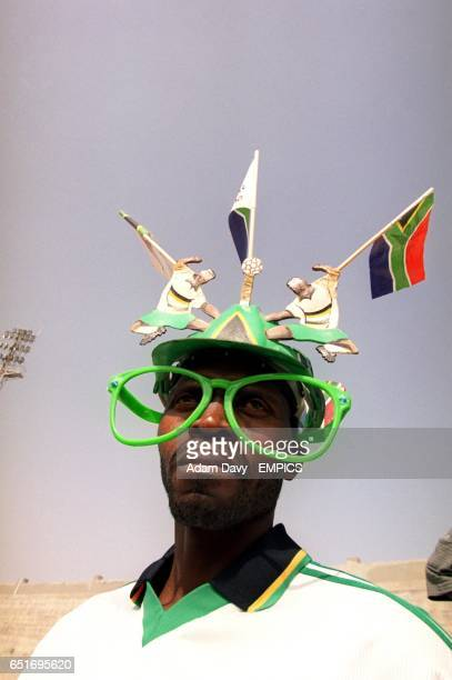 A South Africa fan wearing a novelty hat and glasses