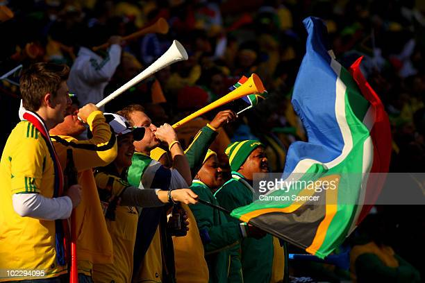 South Africa fans blow vuvuzelas as they enjoy the atmosphere prior to the 2010 FIFA World Cup South Africa Group A match between France and South...