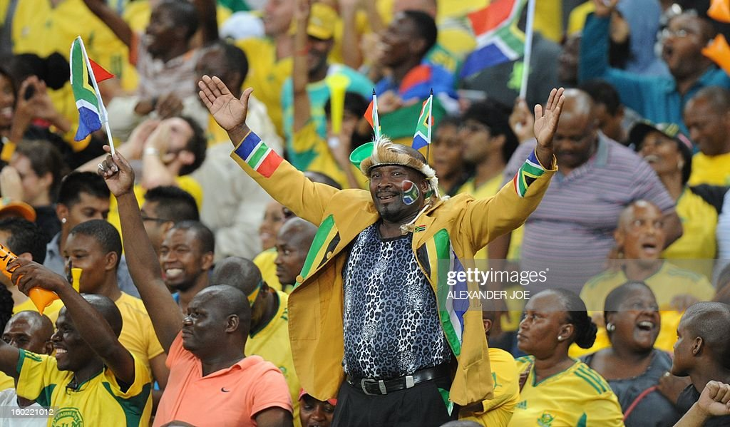 South Africa fans celebrate as their team beat Morocco during a 2013 African Cup of Nations Group A football match at Moses Mabhida Stadium in Durban on January 27, 2013.