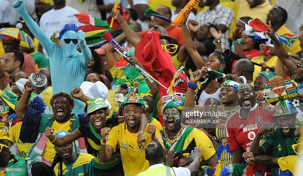 South Africa fans celebrate as their team beat Morocco during a 2013 African Cup of Nations Group A football match at Moses Mabhida Stadium in Durban on January 27, 2013. AFP PHOTO / ALEXANDER JOE