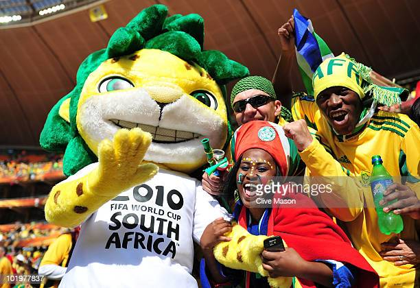 South Africa fans pose with mascot Zakumi before the Opening Ceremony ahead of the 2010 FIFA World Cup South Africa Group A match between South...