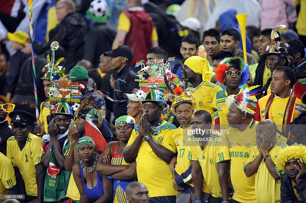 South Africa fans react on January 19, 2013 during a 2013 African Cup of Nation Group A football match against Cape Verde at Soccer City in Soweto. AFP PHOTO / ALEXANDER JOE