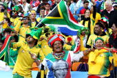 South Africa fans show their support for Nelson Mandela at the Opening Ceremony ahead of the 2010 FIFA World Cup South Africa Group A match between...
