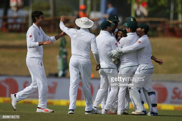 South Africa fielder Temba Bavuma is congratulated after he caught out Bangladesh batsman Mushfiqur Rahim during the second day of the second Test...