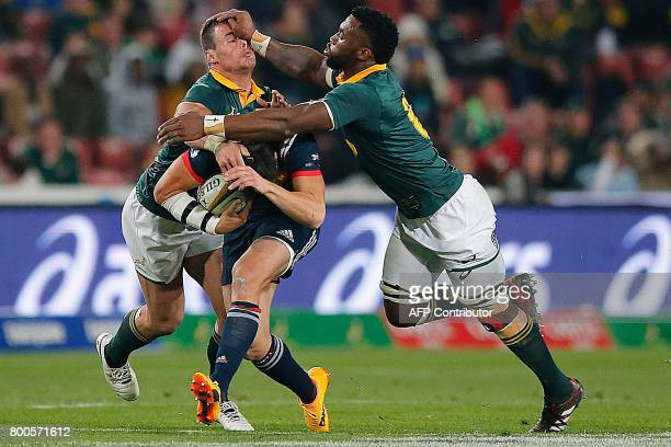 South Africa flanker Siya Kolisi hits in the face South Africa center Jesse Kriel as they try to tackle France flyhalf Francois TrinhDuc during the...