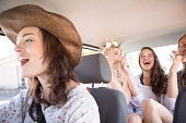 South Africa, Friends on a road trip driving in car