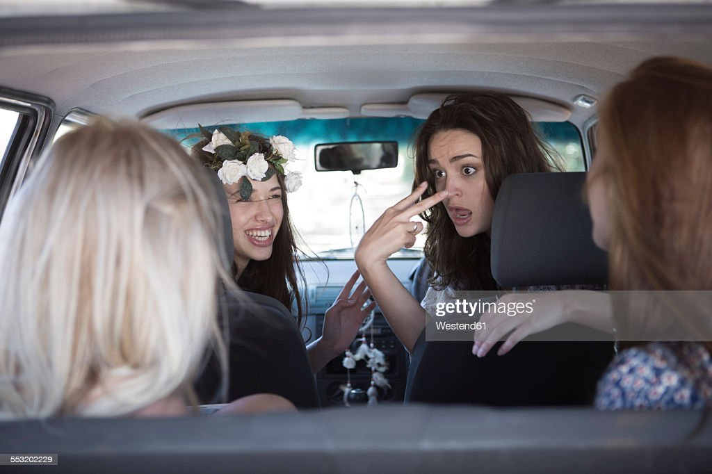 South Africa, Friends on a road trip talking in car