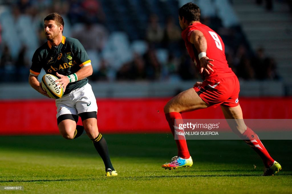 South Africa fullback Willie le Roux (L) breakes through Wales defense during the Rugby union test match between South Africa and Wales on June 21, 2014 at Mbombela stadium in Nelspruit, South Africa.