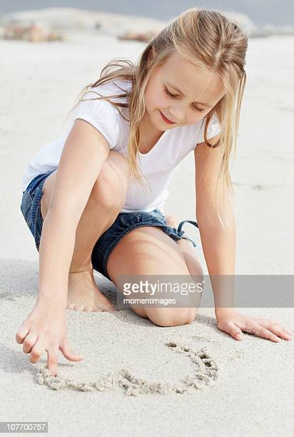 South Africa, Girl (10-11) playing on beach