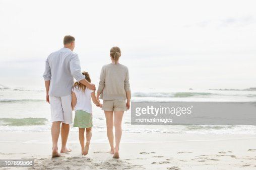 South Africa, Girl (10-11) playing on beach with parents : Stock Photo
