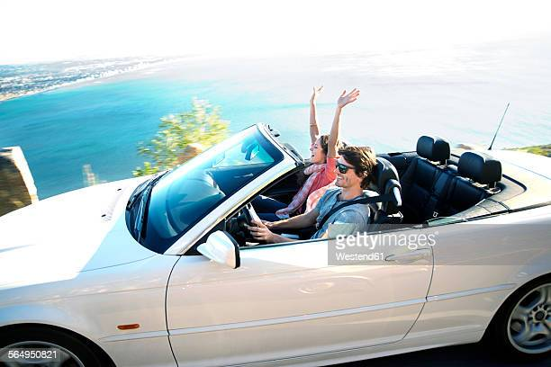 South Africa, happy couple in convertible on coastal road