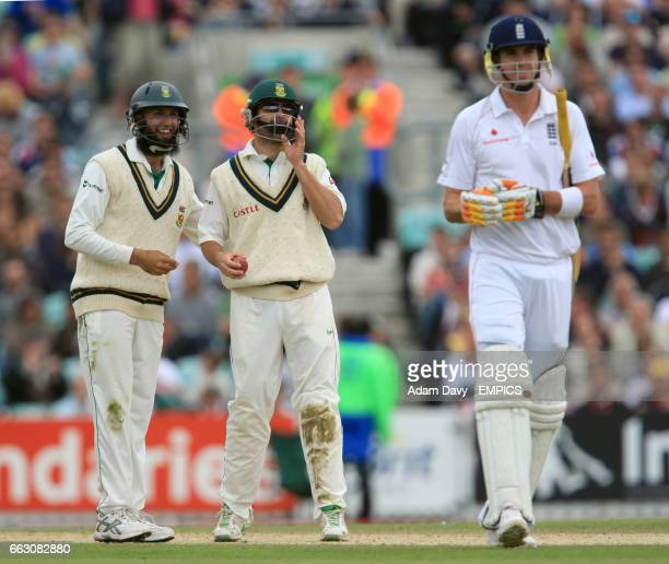 South Africa Hashim Amla and Neil McKenzie celebrate after England's Kevin Pietersen loses his wicket