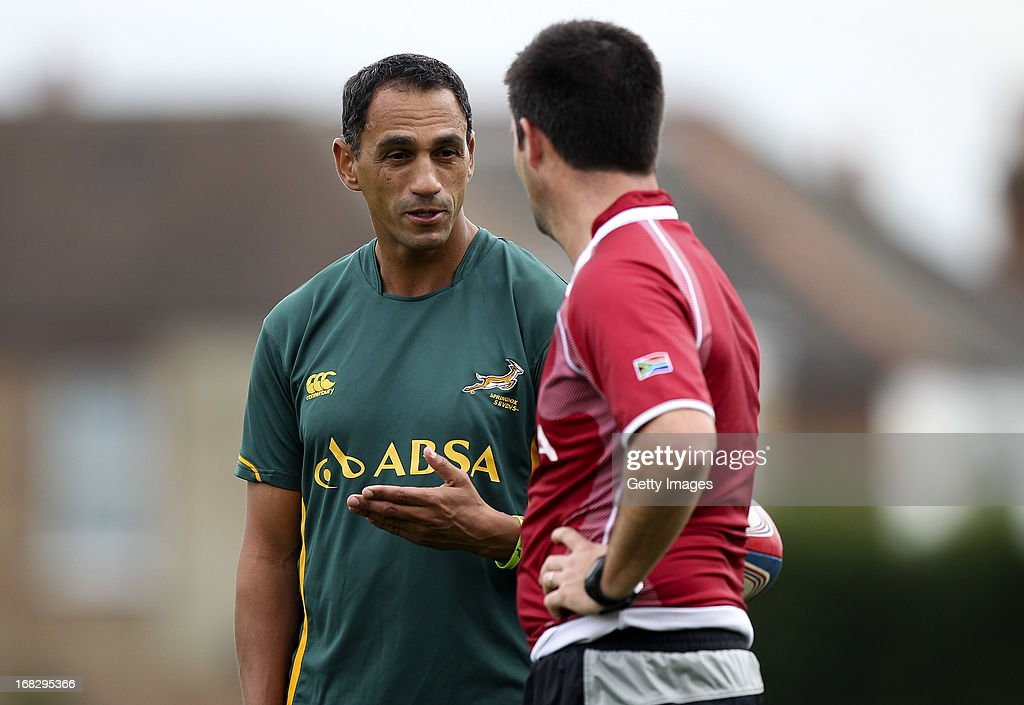 South Africa head coach Paul Treu speaks with one of his coaches during a South Africa Rugby 7's training session at the London Wasps training ground on May 08, 2013 in Acton, England.