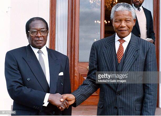 South Africa Nelson Mandela as President pictured with Zimbabwean president Robert Mugabe during a state visit
