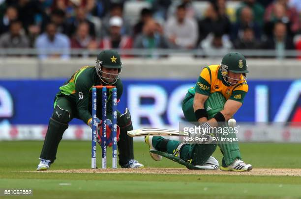 South Africa opening batsman Colin Ingram is trapped LBW by Pakistan bowler Muhammad Hafeez watched by wicketkeeper Kamran Akmal during the ICC...