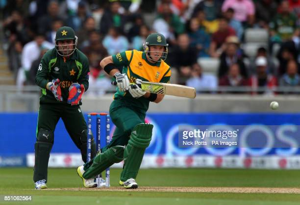 South Africa opening batsman Colin Ingram scores runs watches by Pakistan wicketkeeper Kamran Akmal during the ICC Champions Trophy match at...