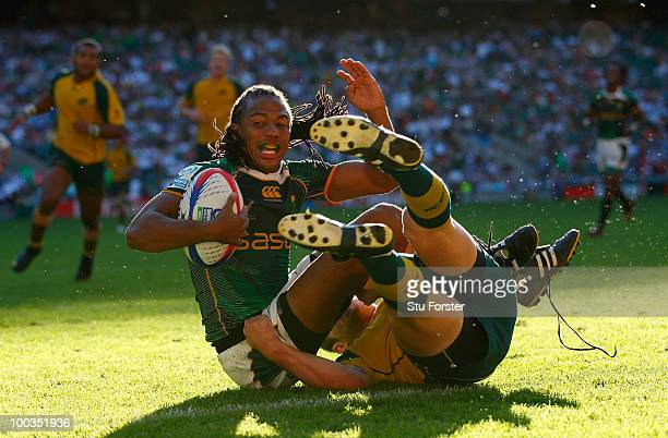 South Africa player Cecil Afrika is tackled just short of the line during the Cup Final between Australia and South Africa during day two of the IRB...