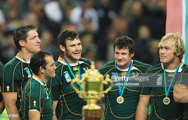South Africa players await the presentation of the trophy following their team's victory during the 2007 Rugby World Cup Final between England and...
