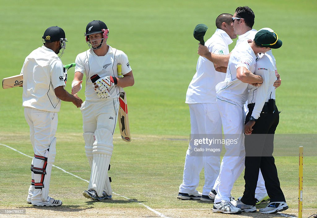 South Africa players celebrate victory on day 4 of the 2nd Test match between South Africa and New Zealand at Axxess St Georges on January 14, 2013 in Port Elizabeth, South Africa.