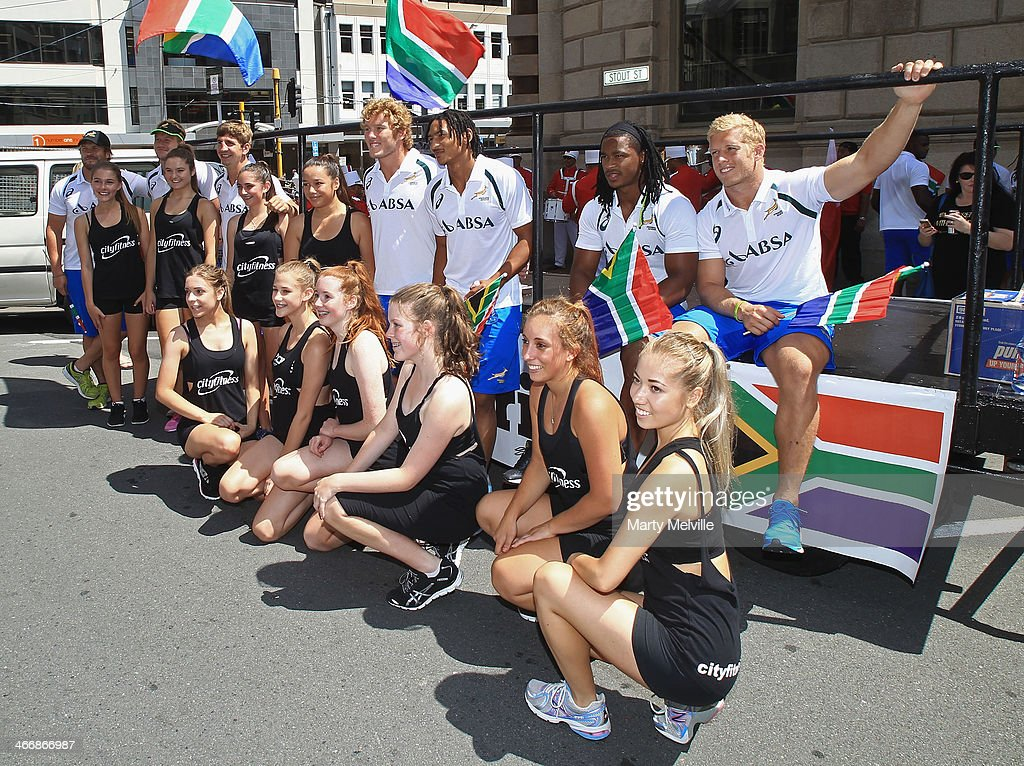 South Africa players pose with a group of young performers during a South African street parade ahead of the 2014 Wellington Sevens on February 5, 2014 in Wellington, New Zealand.