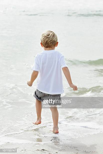 South Africa, Portrait of boy (4-5) playing on beach