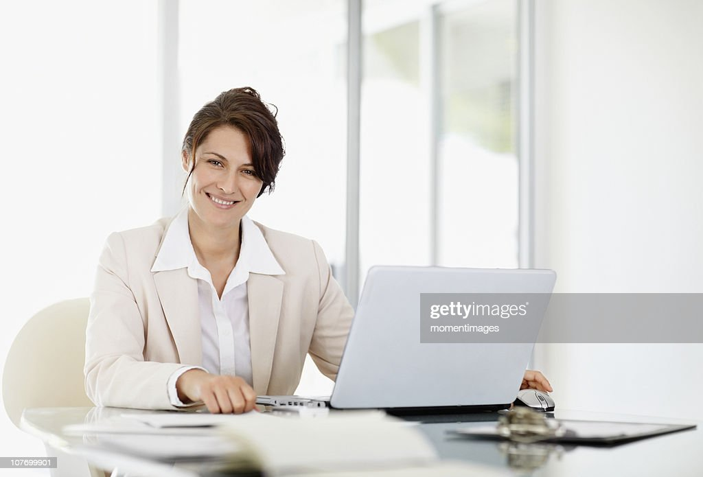 South Africa, Portrait of businesswoman with laptop : Stock Photo