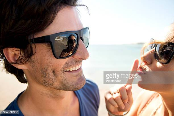 South Africa, portrait of happy couple wearing sunglasses