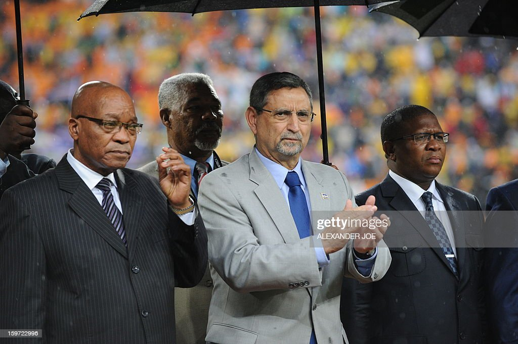 South Africa President Jacob Zuma (L) and Cape Verde President Jorge Carlos de Almeida Fonseca stand during the opening ceremony of the 2013 African Cup of Nations in Soweto on January 19, 2013 at Soccer City.