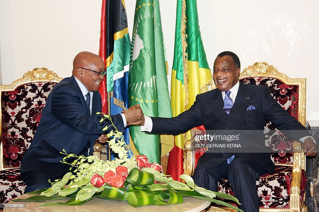 South Africa president Jacob Zuma is welcomed by his Congolese counterpart Denis Sassou Nguesso upon his arrival in Brazzaville on July 22, 2013 to attend Forbes Africa Forum scheduled on July 23. This first Forbes Afrique Forum will be held under the theme 'The emergence of an African middle class: conditions, issues and challenges.'